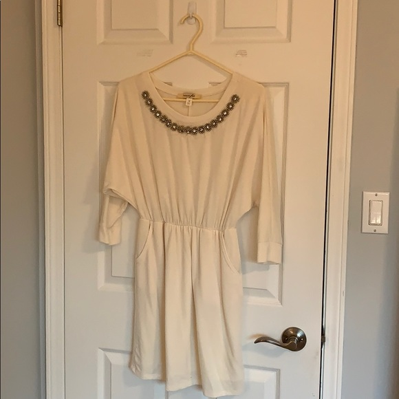 Cream colored soft 3/4 length sleeve dress